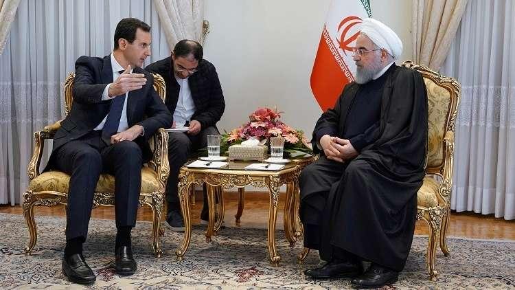 """صورة صحيفة إيرانية: بشار الأسد لم يبلغ """"وليد المعلم"""" بزيارته لإيران"""