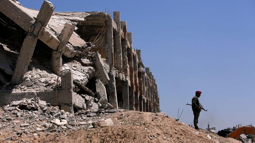 صورة مخابرات إيران تبحث عن جثث قتلاها في غوطة دمشق