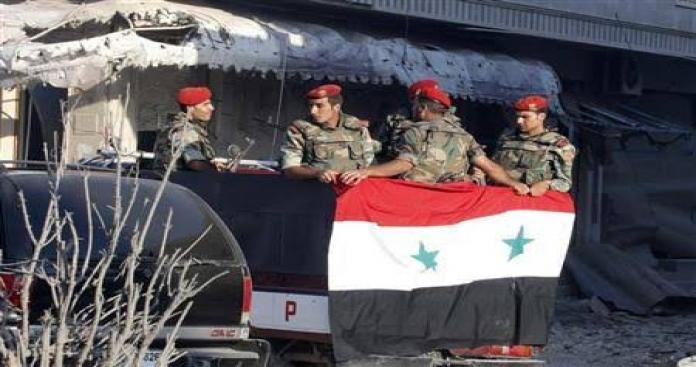 صورة شجار يتحول لمعركة بين عناصر الامن السوري في دمشق