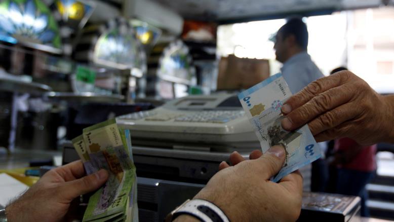صورة في دمشق: الراتب الشهري 50 دولار.. والفقر هو السلطة العليا!