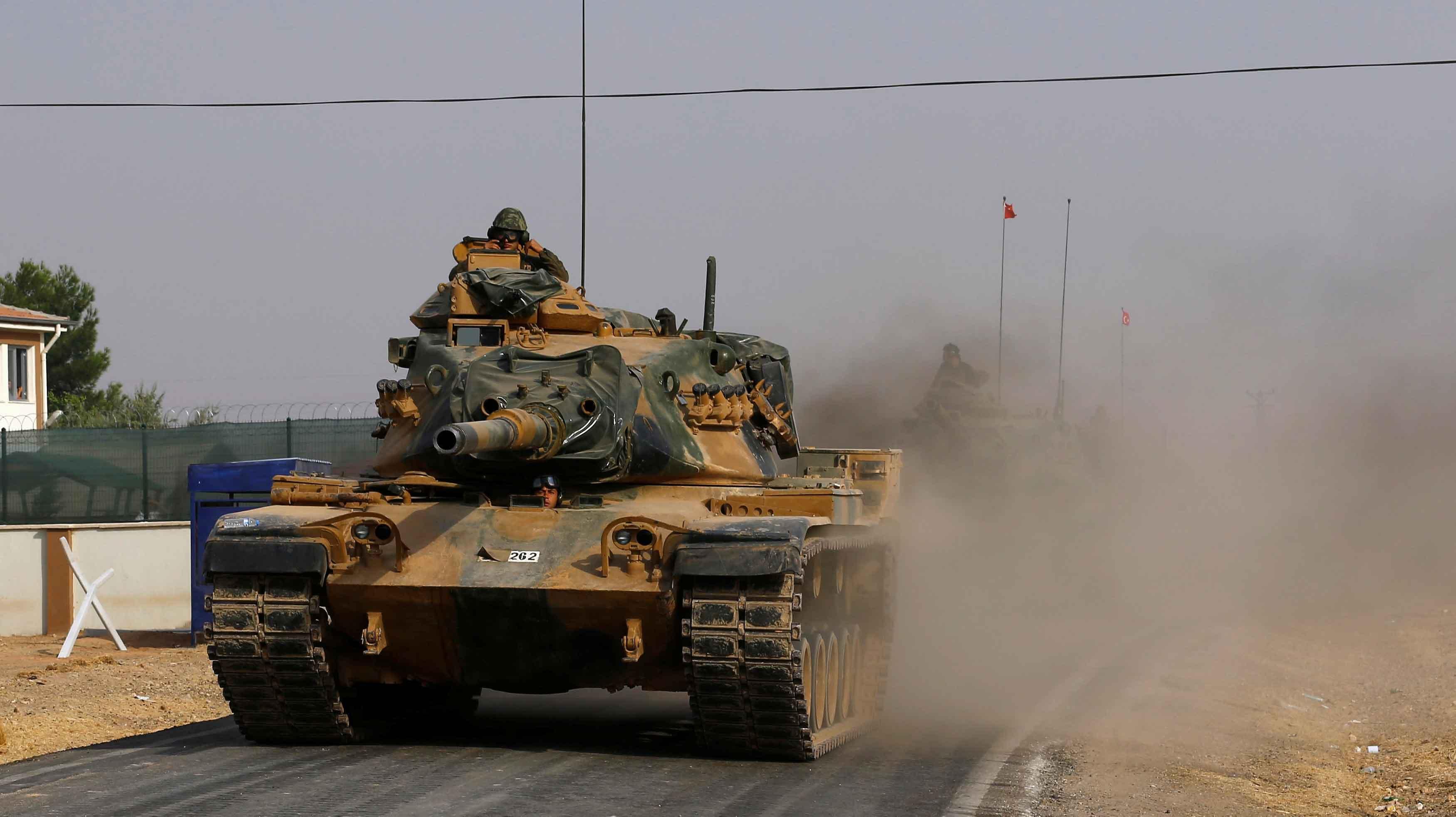 صورة أردوغان يتعهد بتأديب بشار الأسد