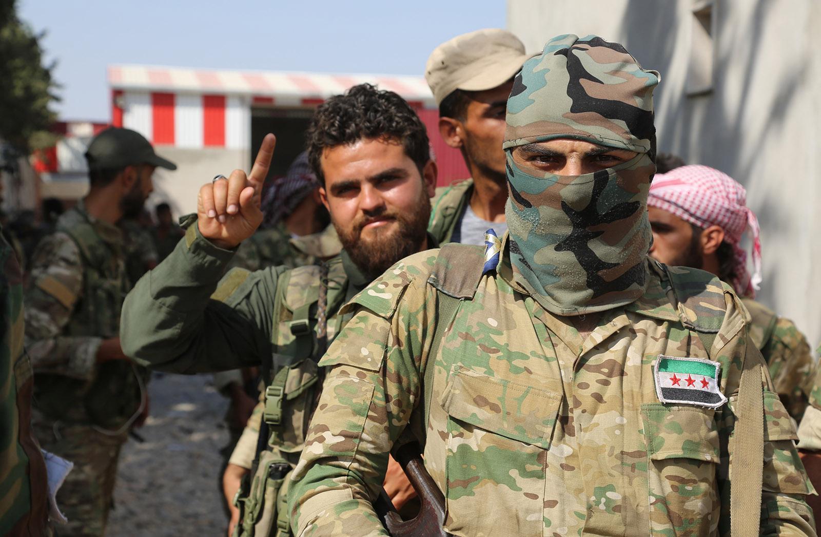 صورة أردوغان: الجيش الوطني السوري يتواجد في ليبيا
