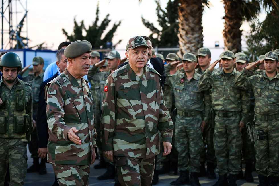 صورة أردوغان يتوعد الأسد ويحذر روسيا